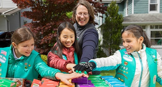 Volunteer helping with Girl Scout Cookie season